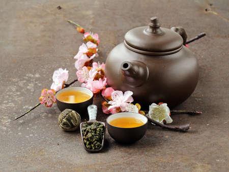 tea set teapot cups and different green tea Standard-Bild