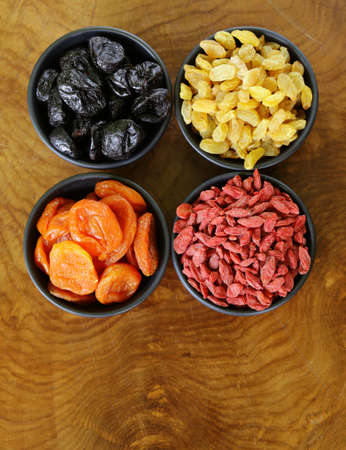 prunes: Assorted dried fruits raisins apricots figs prunes goji cranberries