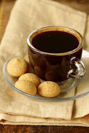 almond biscuit: cup of espresso coffee with almond biscuit (amarettini) Stock Photo