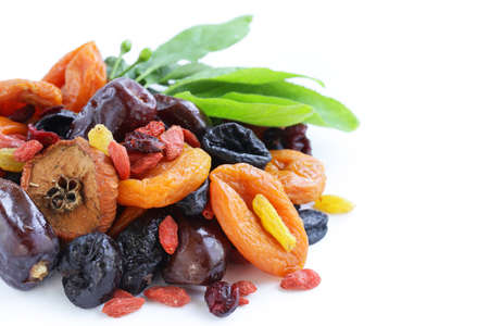 prunes: Assorted dried fruits raisins apricots figs prunes goji cranberries on a wooden background