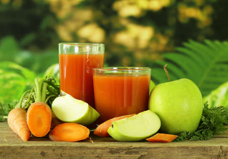 natural organic fresh juice of carrots and green apple  healthy eating