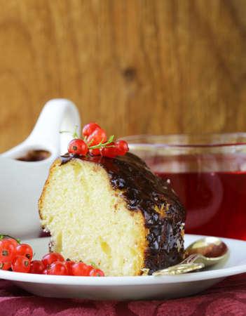 ganache: sponge cake with chocolate ganache and fresh berries Stock Photo