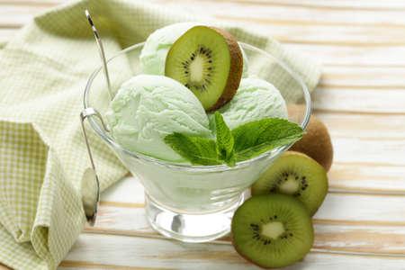 kiwi: fruit creamy ice cream with green kiwi and mint Stock Photo