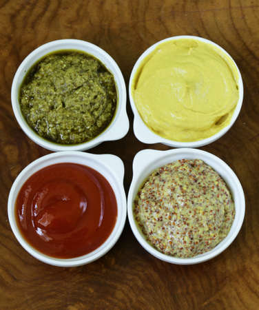 sauces: different types of sauces - ketchup, mustard, pesto