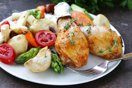 garnish: Fried chicken legs with herbs and spices, vegetables for garnish