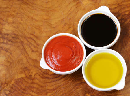 balsamic: traditional Italian sauces - balsamic vinegar, tomato sauce and olive oil Stock Photo