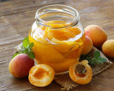 canned peaches fruit in a glass jar