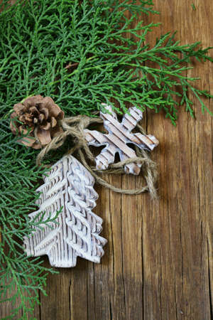 arborvitae: fir branches arborvitae with wooden Christmas decorations