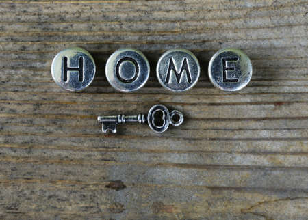metal letters: the word HOME written in metal letters