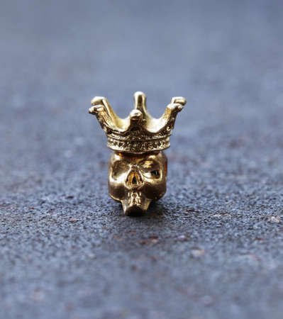 skull with crown: golden metal skull with a gold crown