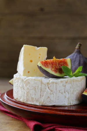 cheeseboard: Cheese with white mold Camembert, Brie with fresh figs