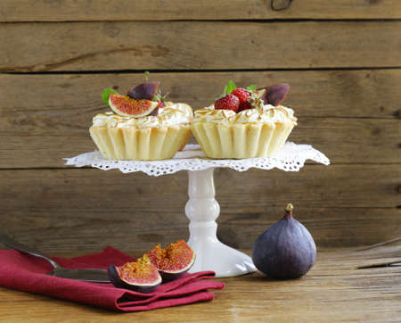 pastry: dessert tartlets from shortcrust pastry with meringue and fruit