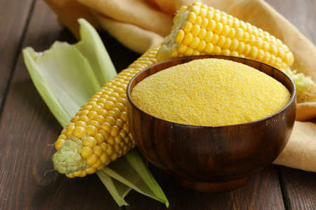 grits: Natural organic corn grits and cobs on the wooden table