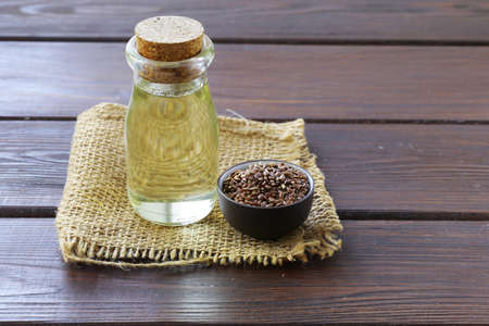 flax seed oil: flax seed oil in glass bottles on a wooden table