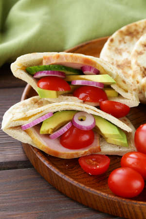 tortillas: homemade tortillas pita stuffed with vegetables and meat