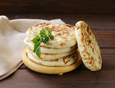tortillas: stack of homemade tortillas pita on a wooden table