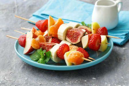 the mixed: fruit on wooden skewers - dessert skewers Stock Photo