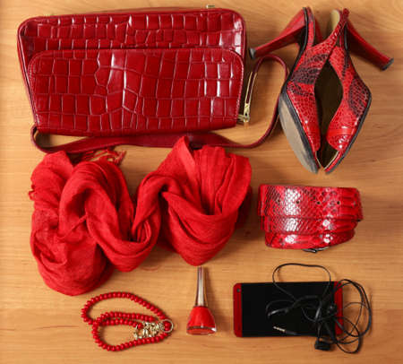 casual clothing: Women accessories red bags, shoes, belt and scarf Stock Photo