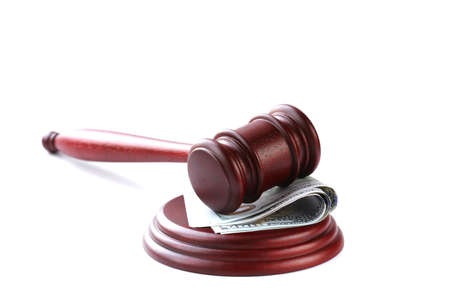 lawyer symbol: gavel on a stand  with money  US dollars on a white background