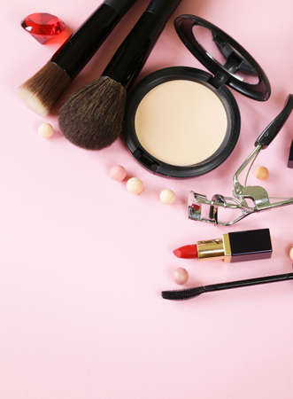 cosmetics set for make-up face powder, lipstick, mascara brush Archivio Fotografico