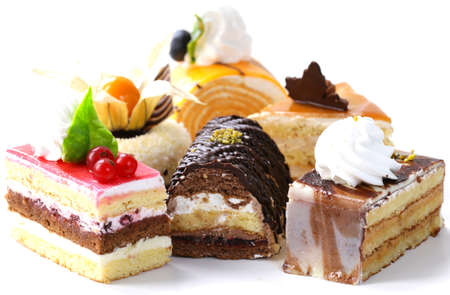 Assorted different mini cakes with cream, chocolate and berries Banque d'images