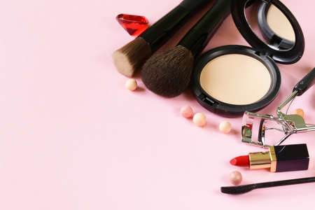 make up products: cosmetics set for make-up face powder, lipstick, mascara brush Stock Photo