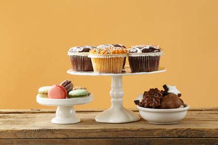 dessert buffet: dessert buffet muffins, cookies, macaroon on a wooden table