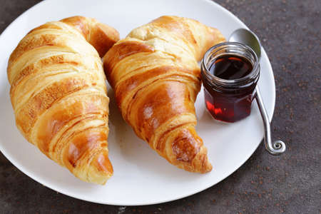 croissant: traditional croissants with jam for breakfast