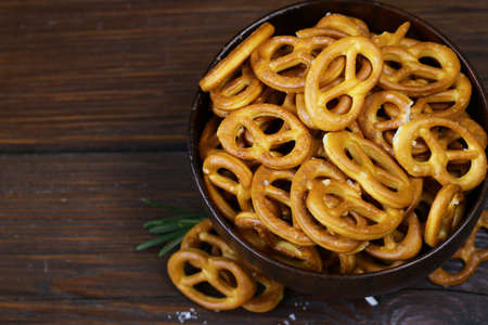salty: Salty snacks mini pretzels with salt and spices
