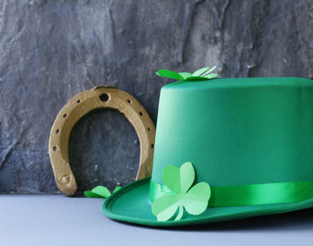 irish culture: traditional symbols for Patricks Day - green hat, horseshoe and clover
