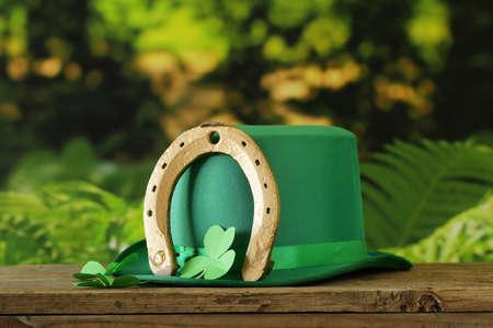 leprechaun background: traditional symbols for Patricks Day - green hat, clover
