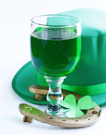green beer: traditional symbols for Patricks Day - green beer, horseshoe and clover Stock Photo