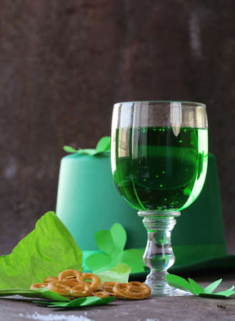 green beer: traditional symbols for Patricks Day - green beer and clover Stock Photo