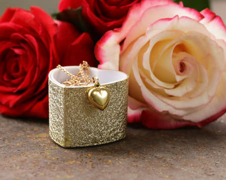 gold necklace: gold necklace heart with roses flowers for gift Stock Photo