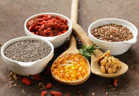 maca: Super food - goji berries, chia seeds, flax seeds, walnuts and omega-3 capsules