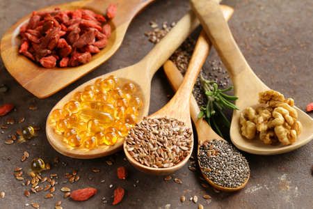 omega3: Super food - goji berries, chia seeds, flax seeds, walnuts and omega-3 capsules