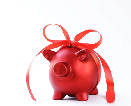 savings and loan crisis: red piggy bank with gift ribbon on white background