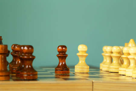 business symbols metaphors: chess position - pawn standing in a position of checkmate Stock Photo
