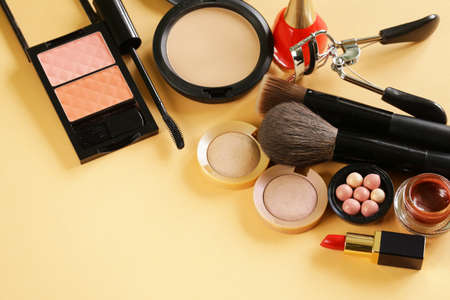 blush: cosmetics set for make-up face powder, lipstick, mascara brush, nail polish, blush, eye shadow