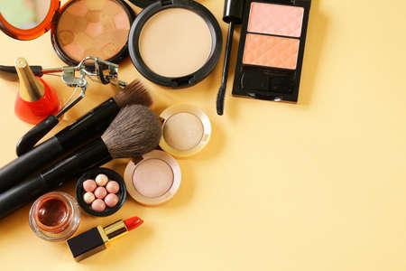set up: cosmetics set for make-up face powder, lipstick, mascara brush, nail polish, blush, eye shadow
