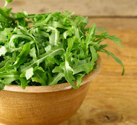 rukola: bowl of fresh green, natural salad arugula