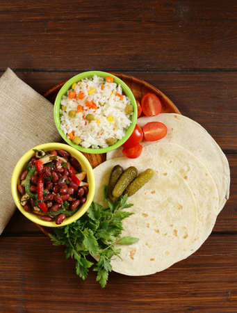 gourmet food: Mexican food is tacos on wheat tortilla with chicken and beans