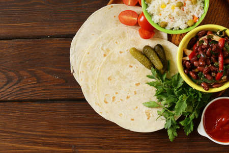 delicious food: Mexican food is tacos on wheat tortilla with chicken and beans