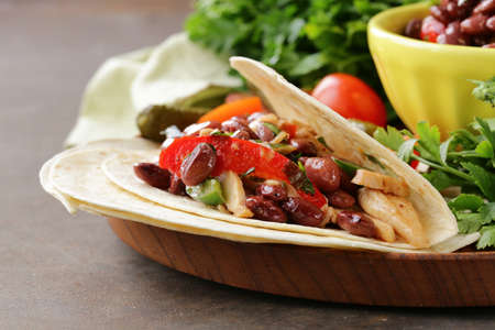 red food: Mexican food is tacos on wheat tortilla with chicken and beans