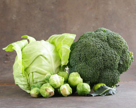 different kinds of cabbage - broccoli, Brussels sprouts and white cabbage