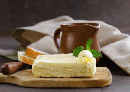 butterfat: block of fresh organic butter on a wooden board Stock Photo