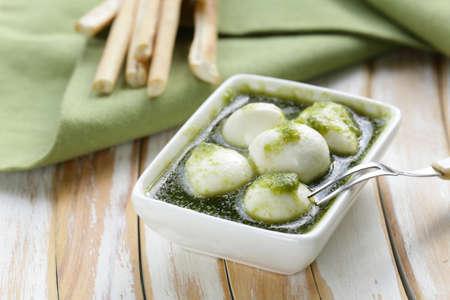 antipasti: Italian antipasti mozzarella cheese with green pesto Stock Photo