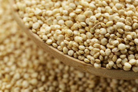 protein crops: Quinoa grain in a wooden spoon close-up shot Stock Photo
