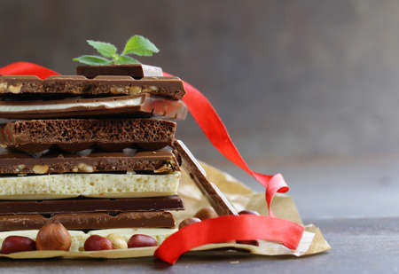 different chocolate bars - white, milk, black and nuts Stock Photo