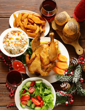 traditional food for Christmas dinner, festive table setting and decorations Stock Photo